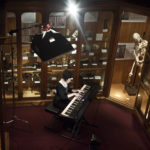 """Jill Tracy composing inside the Mutter Museum"" – Photo by Evi Numen"